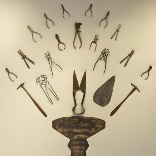Katy Gillam Hull's metal tools and artefacts displayed symmetrically on the gallery wall