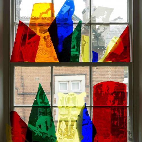 Translucent coloured filter pieces surimposed onto gallery window