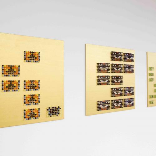 Mosaic representations of butterflies on a gold rectangular background
