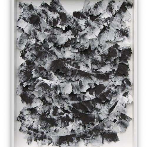 Graphite, framed rectangular composition of pieces of papier mache painted black and white and hanging from wires hung across the frame