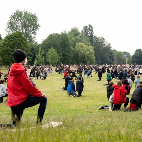 Protestors kneeling in Verulamium Park