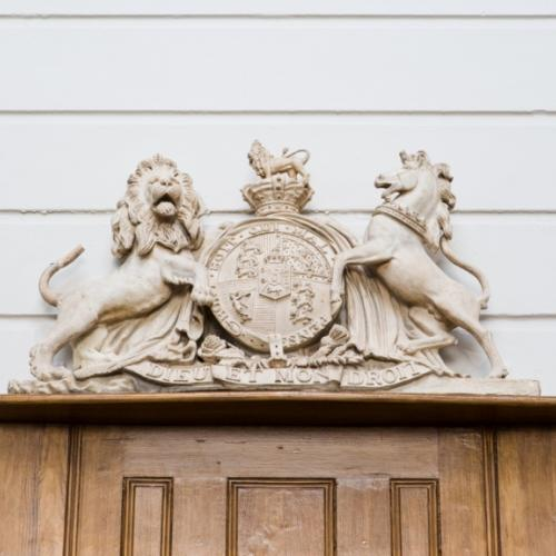 Close-up of the crest in the courtroom in St Albans Museum + Gallery