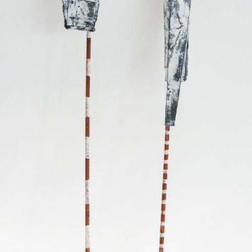 Markerland II, two sticks painted with coloured stripes with paper tied around their ends