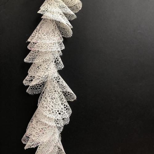 Eternal flow, hung plastic bags resembling lace
