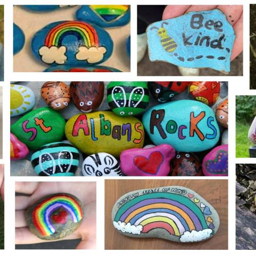 "A group of painted rocks including rainbows  and messages including ""stay strong"" and ""bee kind"""