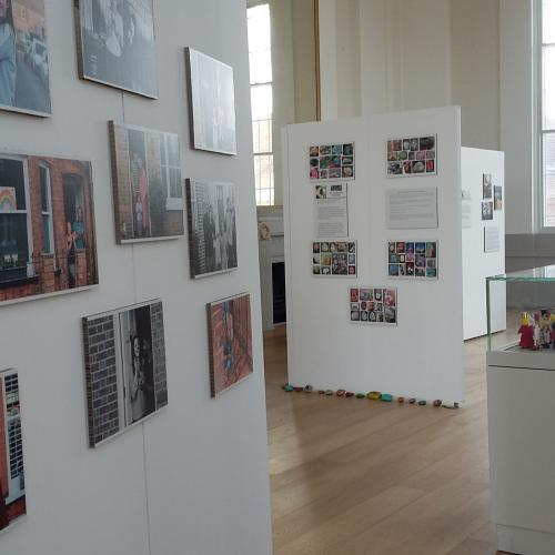 photographs of Clap for Carers on display in the Assembly Room with more walls and cases behind