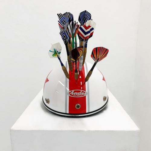 Untitled (Helmet and Darts), darts on top of a white helmet with a single red stripe, facing front