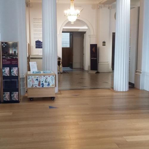 The museum entrance and foyer with triangles on the floor marking routes