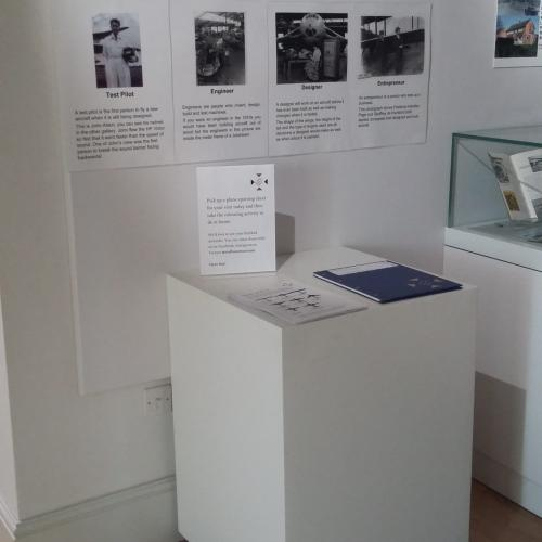 Handley Page exhibition showing a plinth with large text information and activity sheets for children (but no pencils)