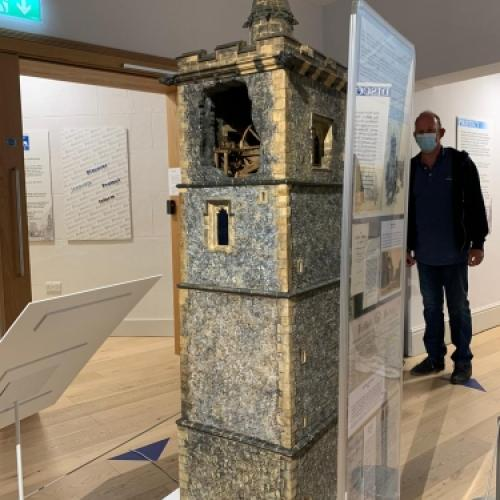 A scale model of St Albans Clock Tower with the top floor left open so you can see the bell mechanism