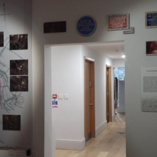 The second gallery of the exhibition showing a wall of aerial photographs taken over the site of Verulamium