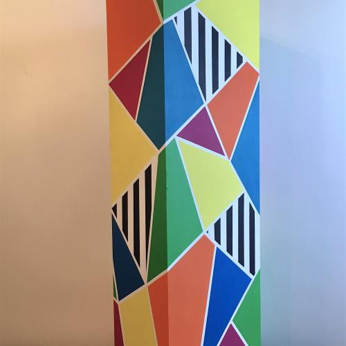 Plinth, geometric coloured patterns painted on a plinth
