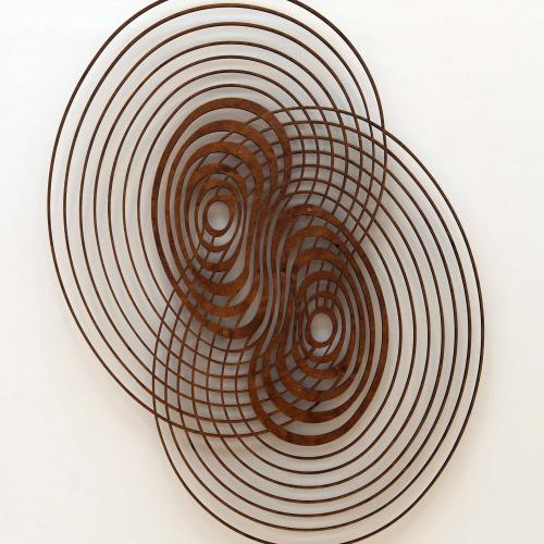 Attractor, two sets of wooden distorted concentric circles joined at their middle