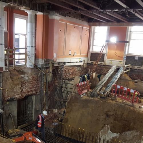 Construction work excavating the basement