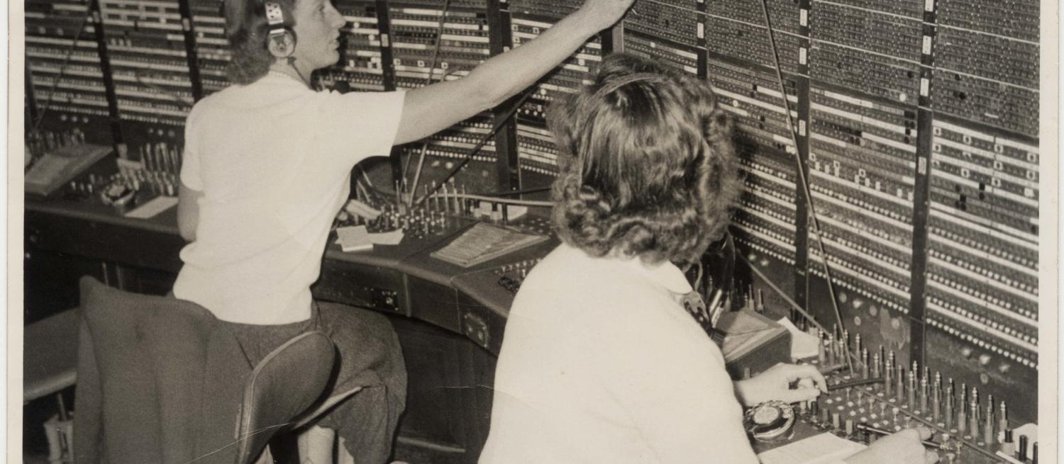 Black and white photo of women at a switchboard