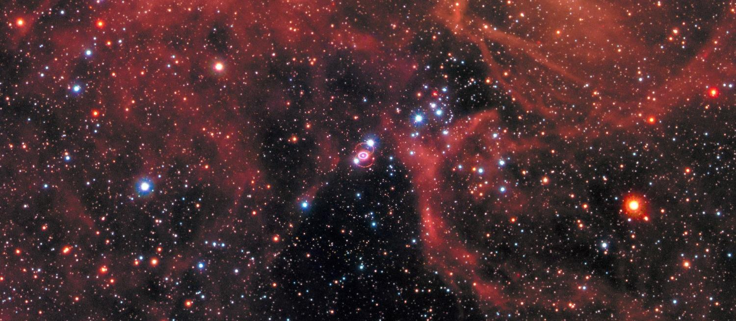 Image of the night sky with a supernova