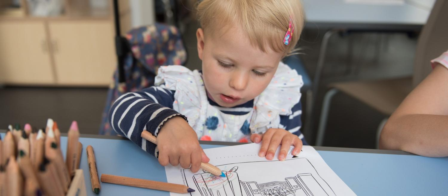 Child colouring in a picture