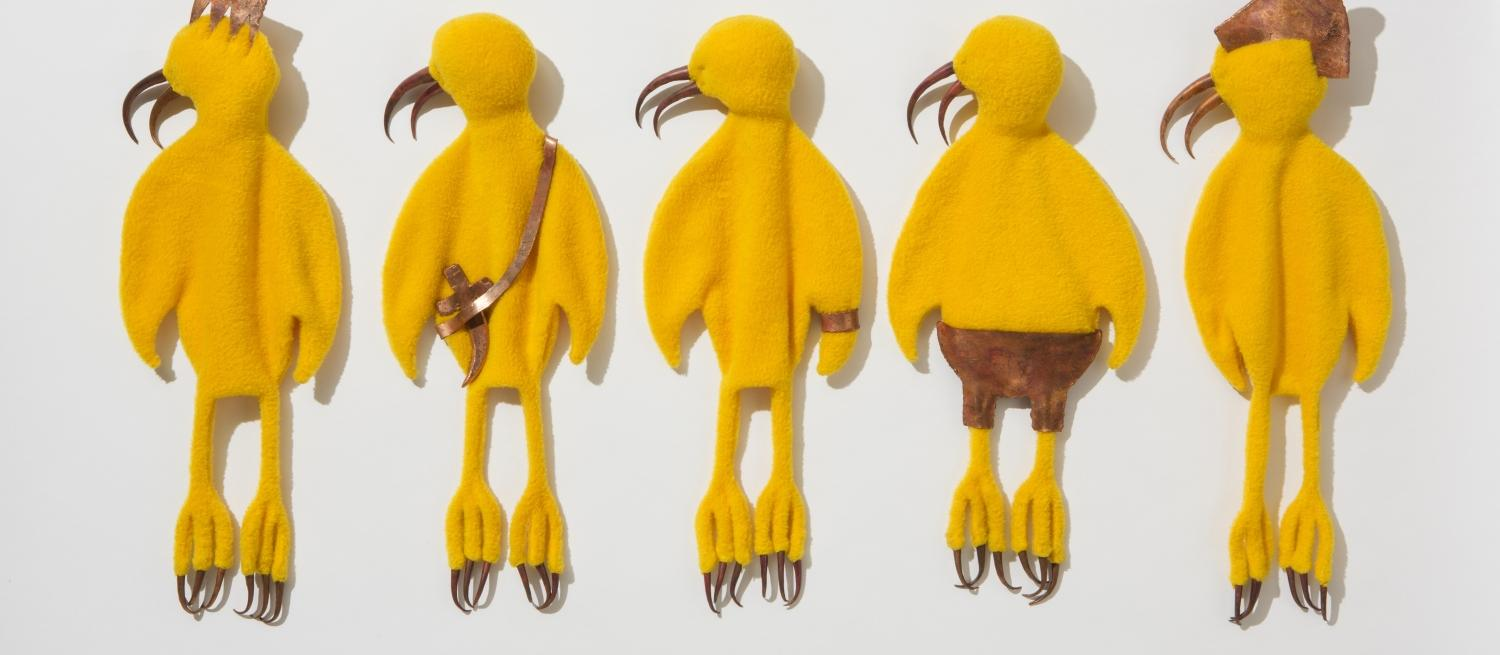 Yellow birds made from fabric and copper