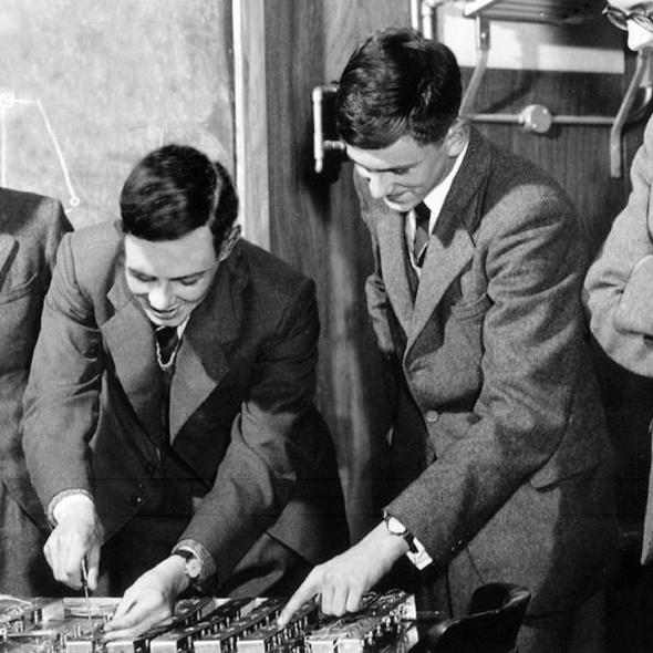 Stephen Hawking (left) in 1958 building a computing engine with other students at St Albans School.