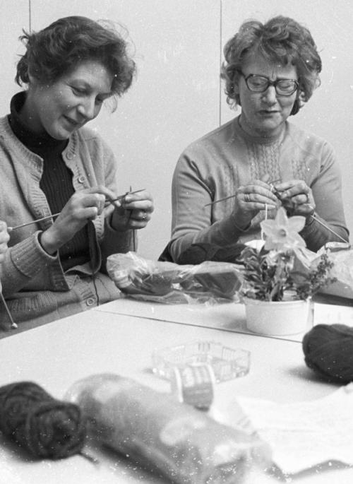 Women sat in a group doing craft