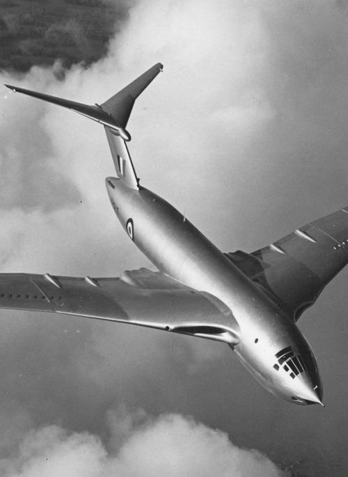 B&W photograph of Victor Aircraft flying over the clouds