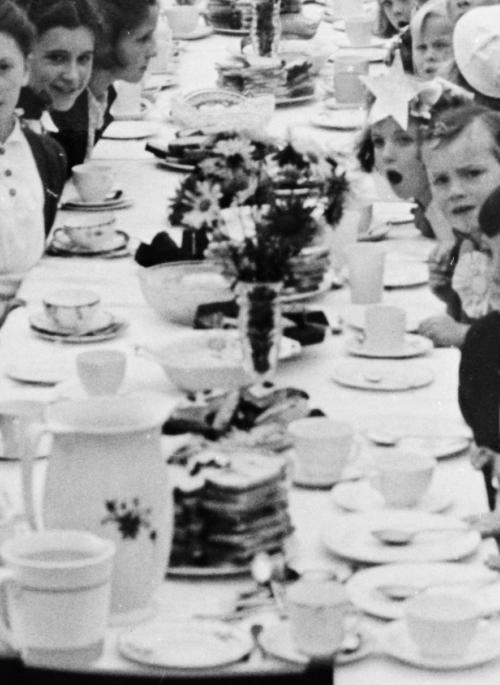 children at a table celebrating VE day